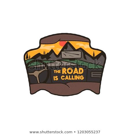 Wanderlust Logo Emblem. Road trip badge. Vintage hand drawn travel patch design. Featuring mountains Stock photo © JeksonGraphics