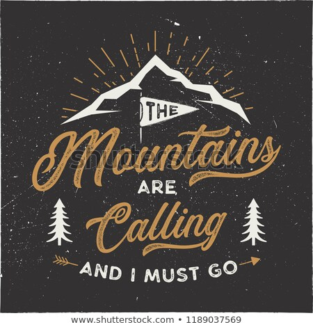 mountains are calling and i must go tee graphic design mountain adventure typography logo vintage stock photo © jeksongraphics