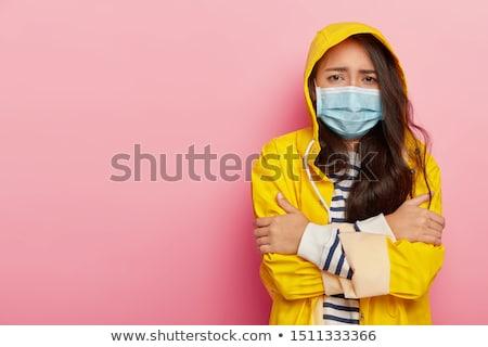 Ontdaan jong meisje regenjas permanente geïsoleerd Stockfoto © deandrobot