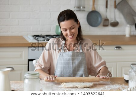 smiling woman preparing cake stock photo © kzenon
