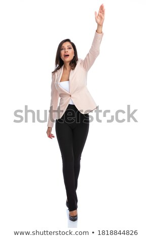 smiling businesswoman steps forward while greeting Stock photo © feedough