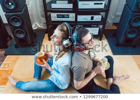 pár · fejhallgató · élvezi · zene · hifi · sztereó - stock fotó © kzenon
