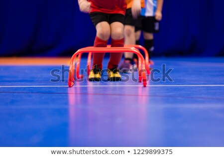 Futsal jumping drills. Futsal indoor soccer training session stock photo © matimix