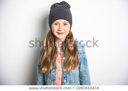 Portrait of a little girl. Studio photography of girl have toque on head Stock photo © Lopolo