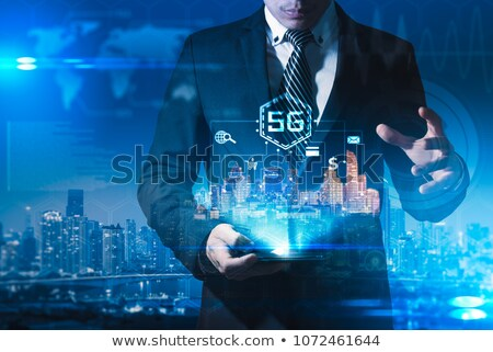 Man touching 3D connectivity and network signs Stock photo © ra2studio