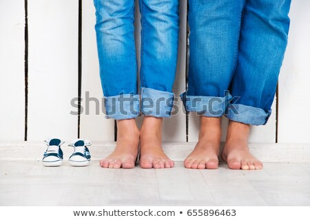 Stock photo: pregnant couple boots
