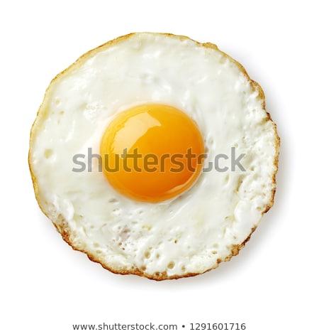 Fried eggs in frying pan Stok fotoğraf © YuliyaGontar