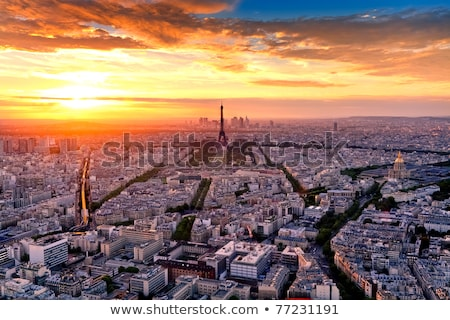 Aerial view of the colorful buildings in european city at sunset Stock photo © denbelitsky