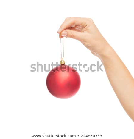 close up of woman hand holding christmas ball stock photo © dolgachov