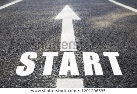 Arrow słowo asfalt drogowego nowego Zdjęcia stock © dolgachov