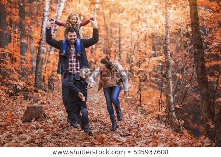 Stock photo: Man With Young Son On Shoulders Autumn Park