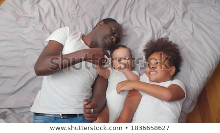 happy father with preteen and baby son at home Stock photo © dolgachov