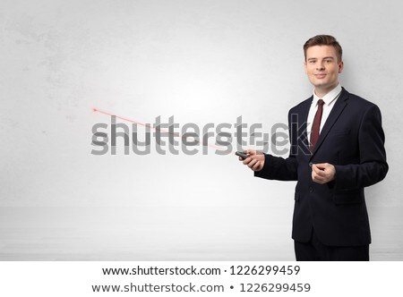 businessman with laser pointer and copyspace white wall foto stock © ra2studio