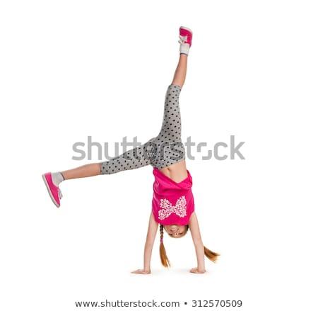 Afbeelding flexibele meisje studio witte glimlach Stockfoto © Lopolo