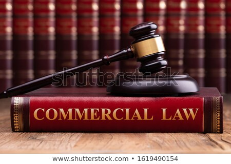 Gavel And Striking Block Over Commercial Law Book On Desk Stock photo © AndreyPopov
