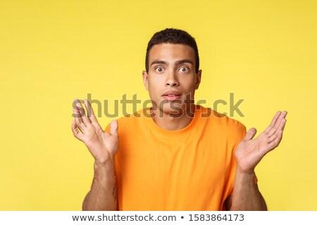 Knap jonge man handen besluiteloos wat Stockfoto © benzoix