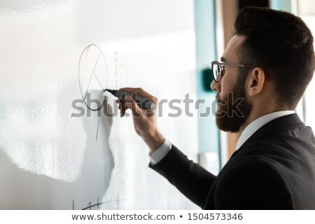 Man Thinking on Presentation and Stats Business Stock photo © robuart