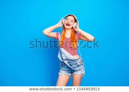 Ginger woman listening to music Stock photo © photography33