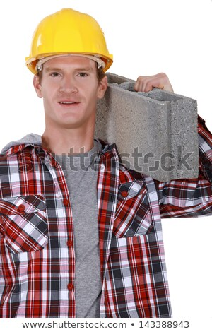 studio portrait of bricklayer carrying concrete block Stock photo © photography33