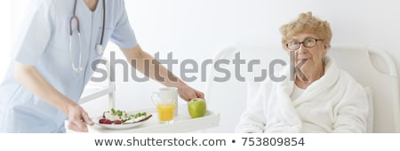 Nurse Serving A Patient A Meal In Her Bed Stock photo © monkey_business