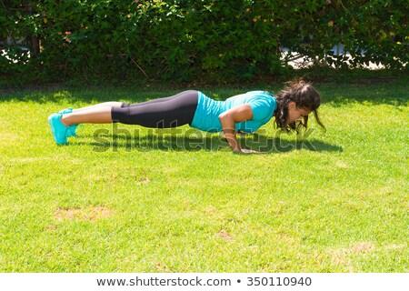 Woman and man doing push ups on a sunny day Stock photo © wavebreak_media