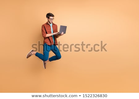 businessman working on laptop and dreaming about traveling in su stock photo © studiostoks