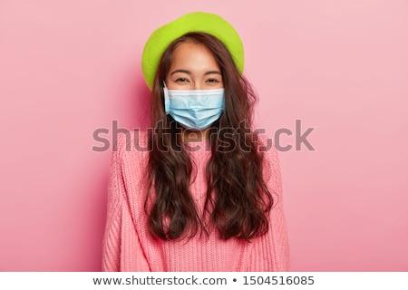 Młoda kobieta sweter stałego odizolowany niebieski Zdjęcia stock © deandrobot
