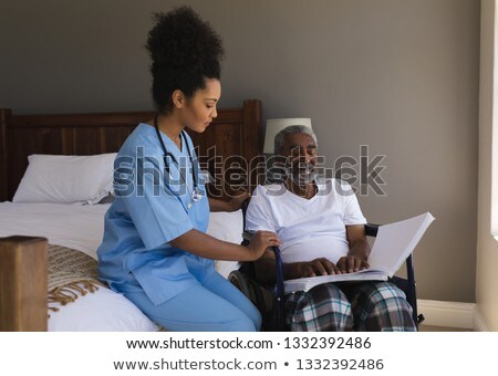 front view of a blind senior african american man reading a braille with young african american fema stock photo © wavebreak_media
