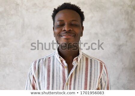 Positive optimistic african young man Stock photo © deandrobot