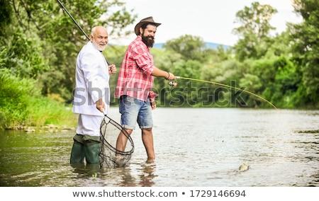 Brodaty rybaka wędka morza molo wypoczynku Zdjęcia stock © dolgachov