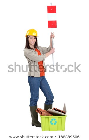 Tradeswoman holding up a sign Stock photo © photography33
