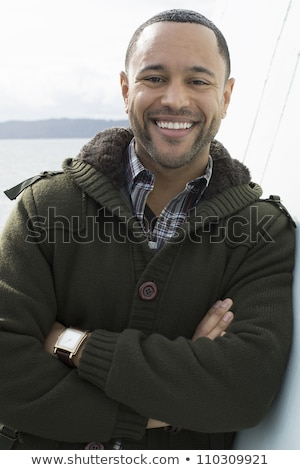 Young Black Man on Boat Deck with Arms Crossed stock photo © Schmedia