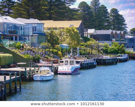 Private Pier with Yacht by Coastal Homes stock photo © dbvirago