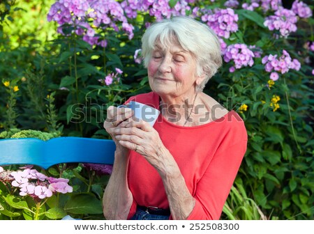 Thoughtful Woman with Coffee Closing her Eyes Stock photo © dash