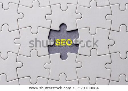 Efficiency - Puzzle on the Place of Missing Pieces. Stock photo © tashatuvango