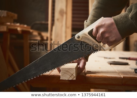 Hand with saw Stock photo © goir