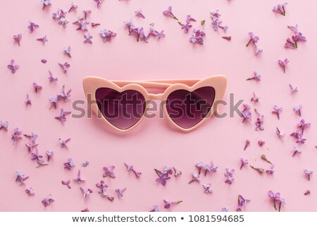 woman in sunglasses in pink paper flower Stock photo © LightFieldStudios