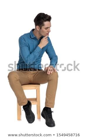 задумчивый Smart случайный человека сидят глядя вниз Сток-фото © feedough