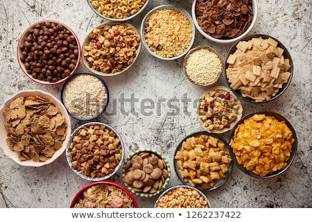 Stock photo: Assortment of different kinds cereals placed in ceramic bowls on table