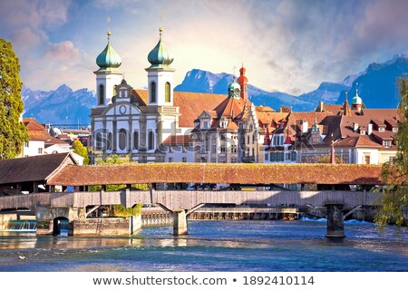 Luzern church and Reuss river waterfront dawn view Stock photo © xbrchx
