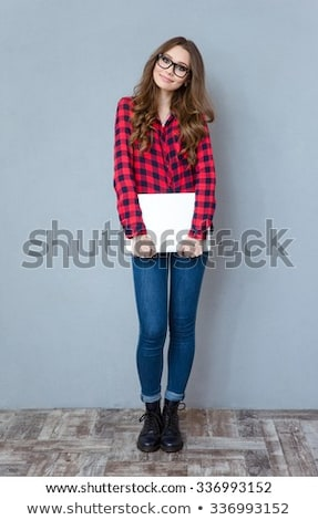 smiling red haired student girl in glasses Stock photo © dolgachov
