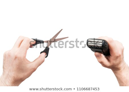 electric razor in a hand on white background Stock photo © Lopolo