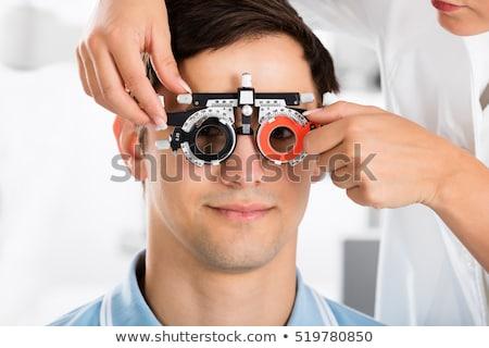 Női szemorvos felfelé beteg szem szemorvos Stock fotó © Elnur