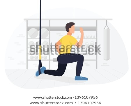 Suspension straps exercises man training arms workout at outdoor gym. Athlete holding suspended trx  Stock photo © Maridav