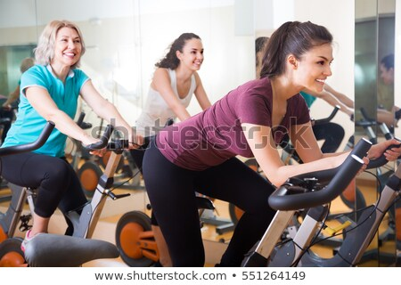 portrait of a woman on exercise bike Stock photo © photography33