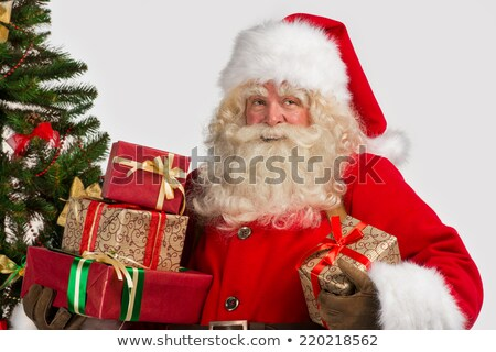 Portrait of Santa Claus with giftboxes looking away Stock photo © HASLOO