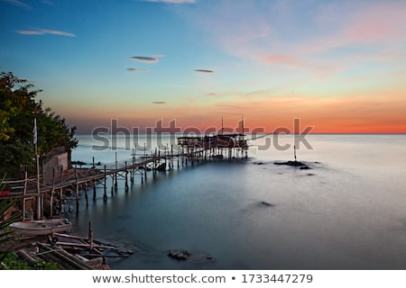 dramatic image of an old fishing hut stock photo © stryjek