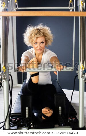 Pilates reformer woman foot work exercise Stock photo © lunamarina