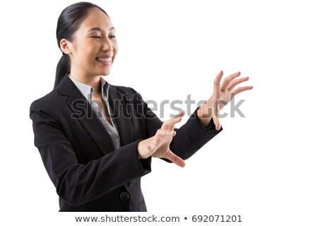 Uśmiechnięty kobieta interesu dotknąć niewidoczny ekranu biały Zdjęcia stock © wavebreak_media