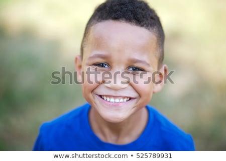 Fiatal srác mosolyog fű természet gyermek jókedv Stock fotó © IS2